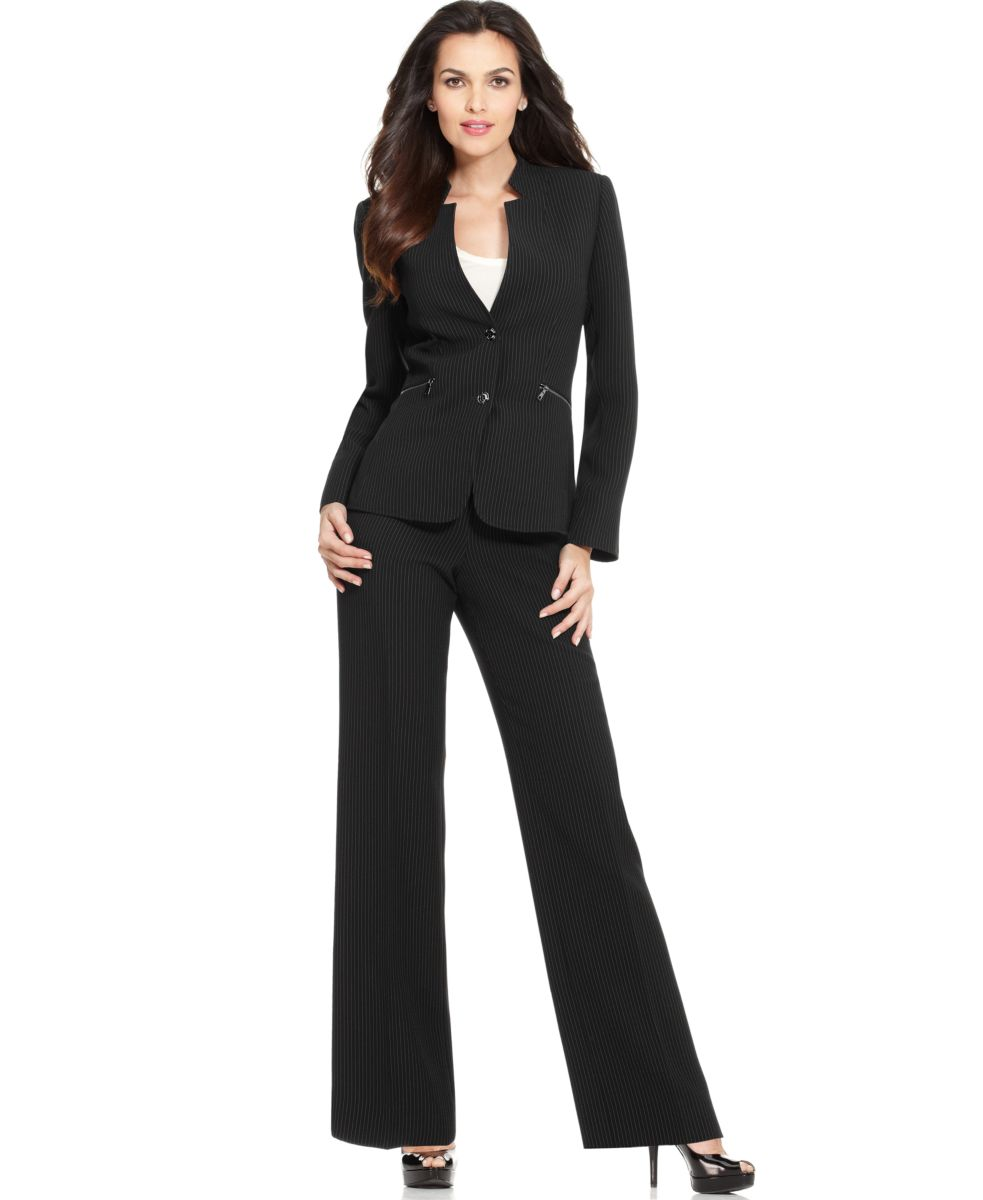 Don't let an all-white suit intimidate you—find a set that's sized to fit petites. An open-front blazer, like this one, allows for layering, and a slim fit trouser will flatter your legs.