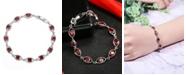 A&M Silver-Tone Garnet Accent Oval Tennis Bracelet